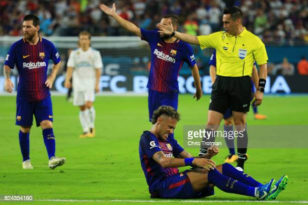 Neymar of Barcelona reacts to a foul in the first half against the Real Madrid during their International Champions Cup 2017 match at Hard Rock...