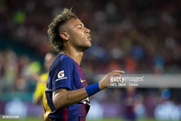 Neymar of Barcelona reacts to a missed shot on goal during the International Champions Cup El Clásico match between FC Barcelona and Real Madrid at...