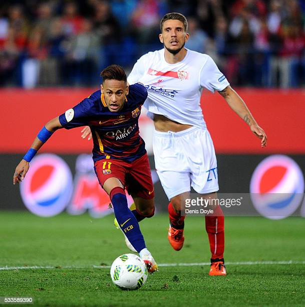 Neymar of Barcelona runs past Daniel Carrico of Sevilla during the Copa del Rey Final between Barcelona and Sevilla at Vicente Calderon Stadium on...