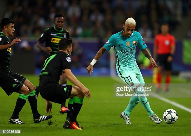 Neymar of Barcelona runs with the ball under pressure from Julian Korb of Borussia Moenchengladbach during the UEFA Champions League group C match...