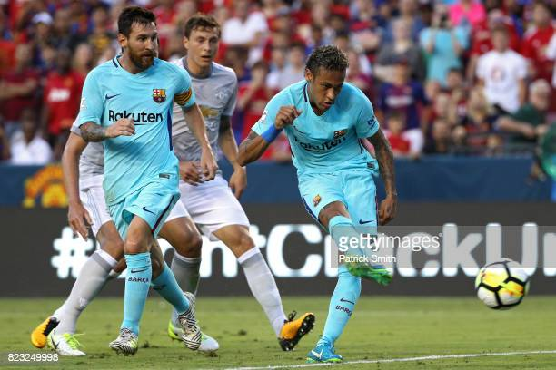 Neymar of Barcelona scores a goal against Manchester United in the first half during the International Champions Cup match at FedExField on July 26...