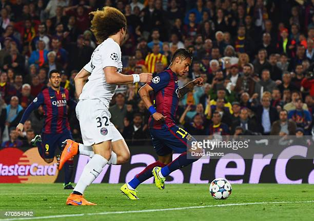 Neymar of Barcelona scores their first goal as David Luiz of PSG looks on during the UEFA Champions League Quarter Final second leg match between FC...
