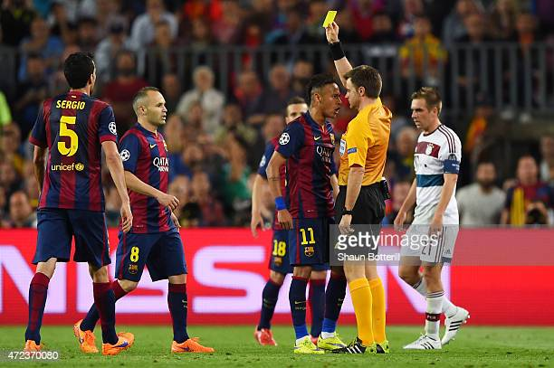 Neymar of Barcelona squares up to Referee Nicola Rizzoli of Italy as he is shown the yellow card during the UEFA Champions League Semi Final first...