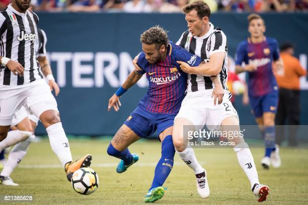 Neymar of Barcelona struggles to get past Stephan Lichtsteiner of Juventus during the International Champions Cup match between FC Barcelona and...