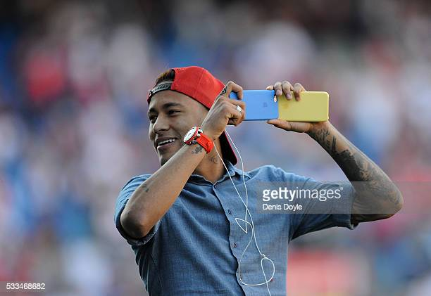 Neymar of Barcelona takes a photograph with his smartphone ahead of the Copa del Rey Final between Barcelona and Sevilla at Vicente Calderon Stadium...