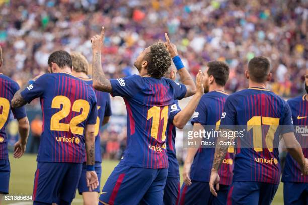 Neymar of Barcelona throws up his hands to the sky to celebrate his goal during the International Champions Cup match between FC Barcelona and...