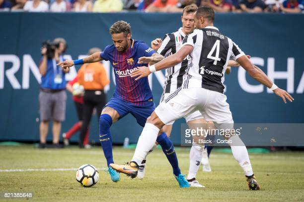 Neymar of Barcelona tries to get past Mehdi Benatia of Juventus and Stephan Lichtsteiner of Juventus during the International Champions Cup match...
