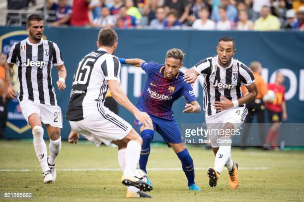 Neymar of Barcelona tries to get past Mehdi Benatia of Juventus and Andrea Barzagli of Juventus during the International Champions Cup match between...
