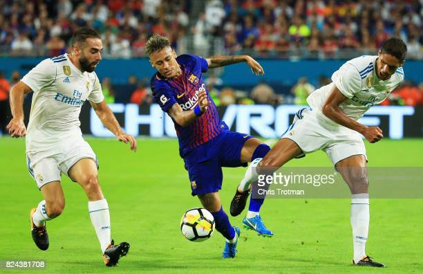 Neymar of Barcelona vies for the ball with Raphael Varane of Real Madrid during their International Champions Cup 2017 match at Hard Rock Stadium on...