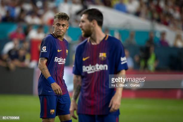 Neymar of Barcelona walks past Lionel Messi of Barcelona during the International Champions Cup El Clásico match between FC Barcelona and Real Madrid...