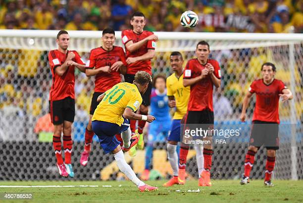Neymar of Brazil akes a free kick during the 2014 FIFA World Cup Brazil Group A match between Brazil and Mexico at Estadio Castelao on June 17 2014...