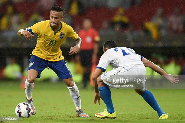Neymar of Brazil and Alfredo Mejía of Honduras compete for the ball during the International Friendly Match between Brazil and Honduras at Beira Rio...