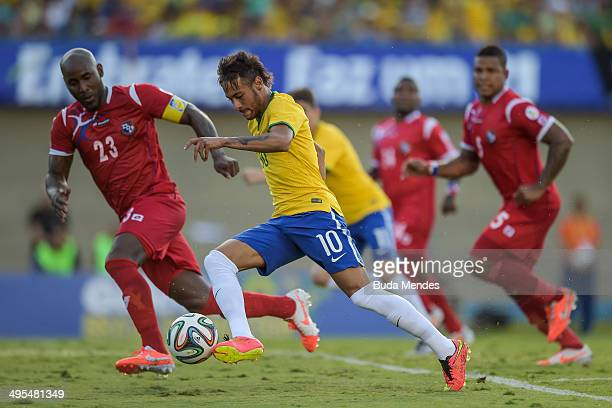 Neymar of Brazil and Felipe Baloy of Panama compete for the ball during the International Friendly Match between Brazil and Panama at Serra Dourada...