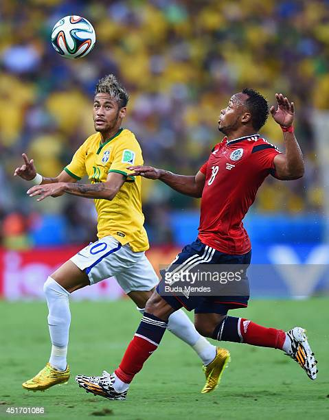 Neymar of Brazil and Juan Camilo Zuniga of Colombia compete for the ball during the 2014 FIFA World Cup Brazil Quarter Final match between Brazil and...
