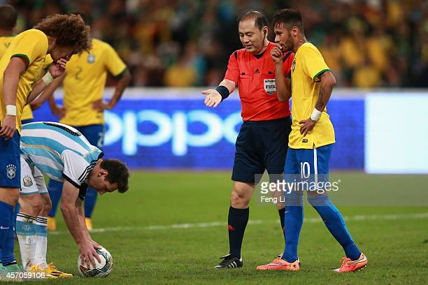 Neymar of Brazil and Lionel Messi of Argentina react during Super Clasico de las Americas between Argentina and Brazil at Beijing National Stadium on...