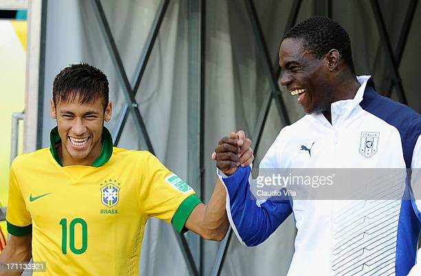Neymar of Brazil and Mario Balotelli of Italy joke prior to the FIFA Confederations Cup Brazil 2013 Group A match between Italy and Brazil at Estadio...