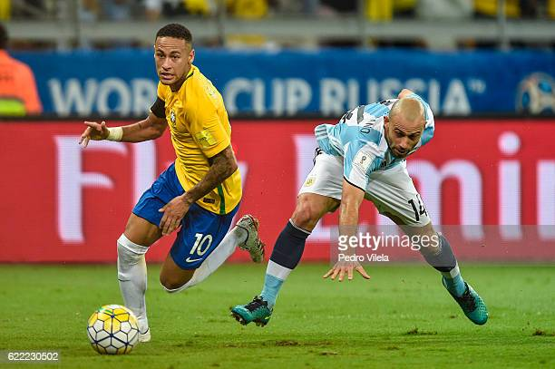 Neymar of Brazil and Mascherano of Argentina battle for the ball during a match between Brazil and Argentina as part 2018 FIFA World Cup Russia...