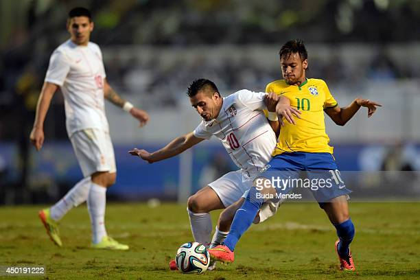 Neymar of Brazil and Tadic of Serbia compete for the ball during the International Friendly Match between Brazil and Serbia at Morumbi Stadium on...