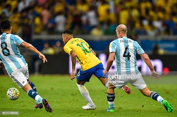 Neymar of Brazil and Zabaleta and Perez of Argentina battle for the ball during a match between Brazil and Argentina as part 2018 FIFA World Cup...