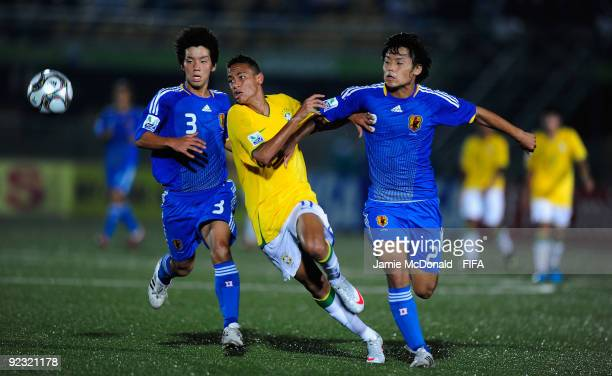 Neymar of Brazil battles with Takuya Okamoto of Japan during the FIFA U17 World Cup match between Brazil and Japan at the Teslim Balogun Stadium on...