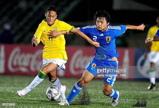 Neymar of Brazil battles with Takuya Okamoto of Japan during the FIFA U17 World Cup match between Brazil and Japan at the Teslim Balogun Stadium on...