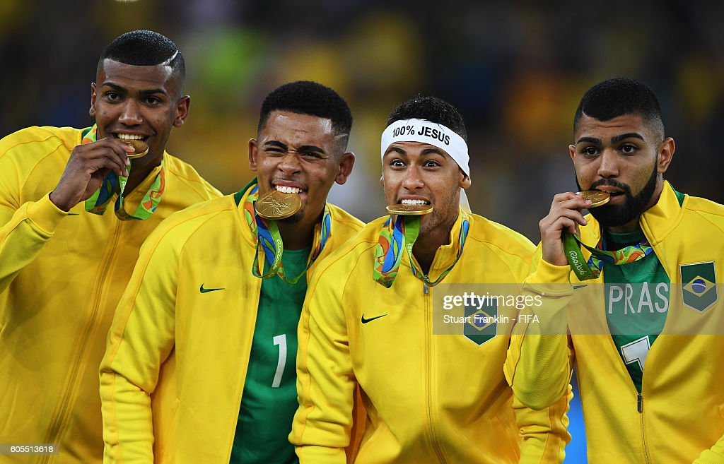 Neymar of Brazil bites his medal after the Olympic Men's Final Football match between Brazil and Germany at Maracana Stadium on August 20, 2016 in Rio de Janeiro, Brazil.