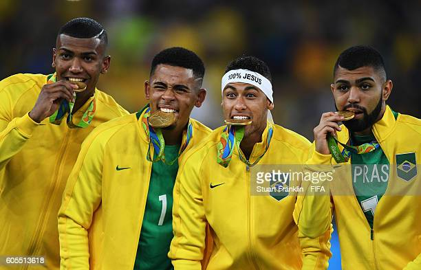 Neymar of Brazil bites his medal after the Olympic Men's Final Football match between Brazil and Germany at Maracana Stadium on August 20, 2016 in...