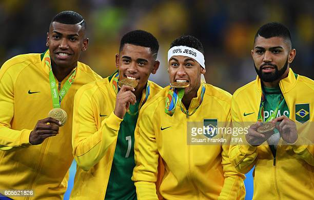 Neymar of Brazil bites his medal after the Olympic Men's Final Football match between Brazil and Germany at Maracana Stadium on August 20 2016 in Rio...