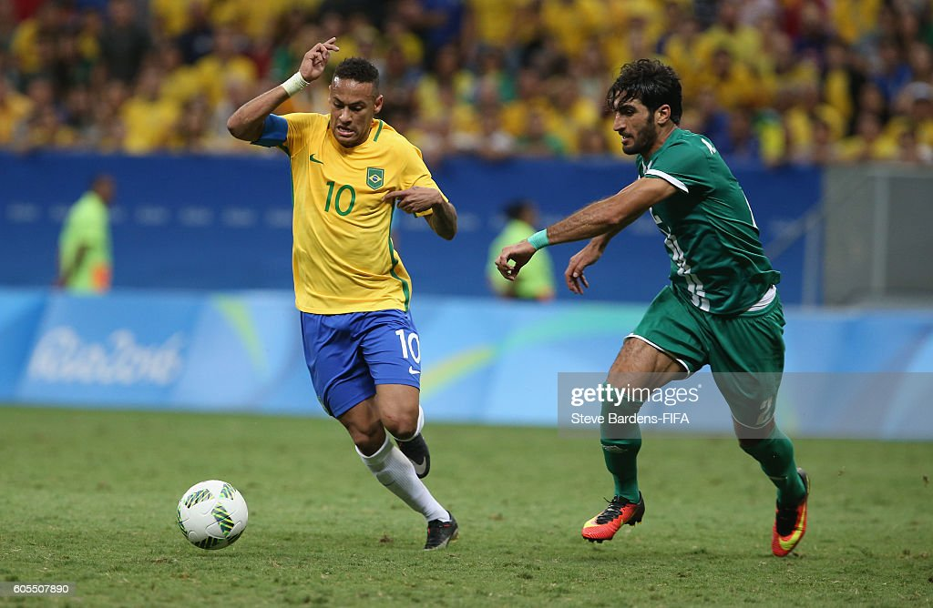 Neymar of Brazil breaks away from Ahmed Ibrahim of Iraq
