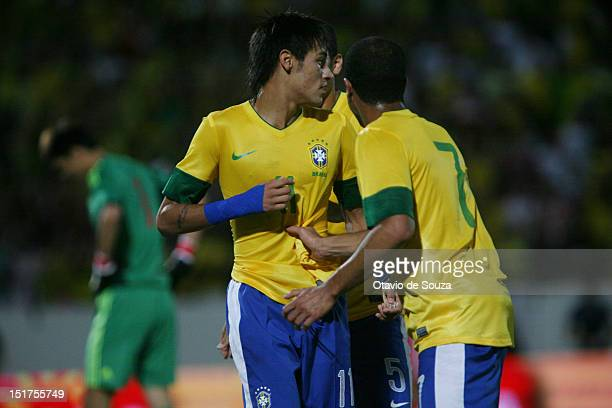 Neymar of Brazil celebrates a scored goal during an international friendly match between Brazil and China at Arruda Stadium on September 10 2012 in...