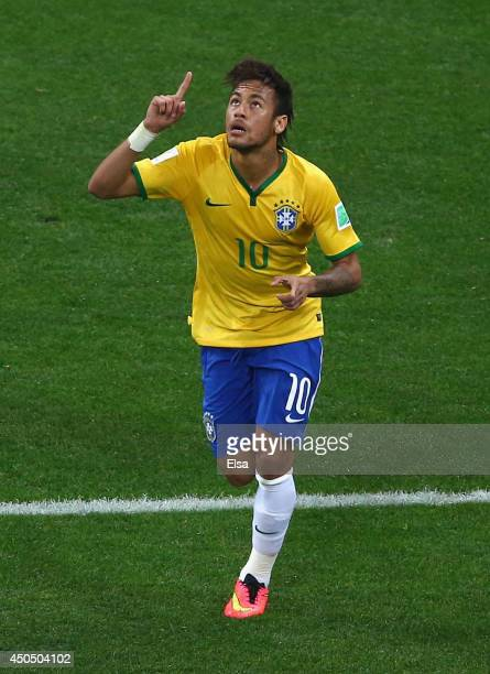 Neymar of Brazil celebrates after scoring a first half goal during the 2014 FIFA World Cup Brazil Group A match between Brazil and Croatia at Arena...