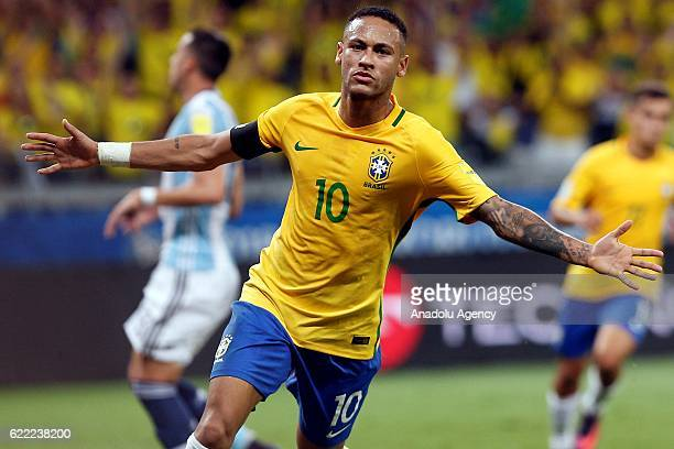 Neymar of Brazil celebrates after scoring a goal during the FIFA 2018 World Cup Qualifier match between Brazil and Argentina at Mineirao Stadium in...