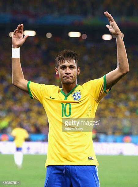 Neymar of Brazil celebrates after scoring his second goal on a penalty kick in the second half during the 2014 FIFA World Cup Brazil Group A match...