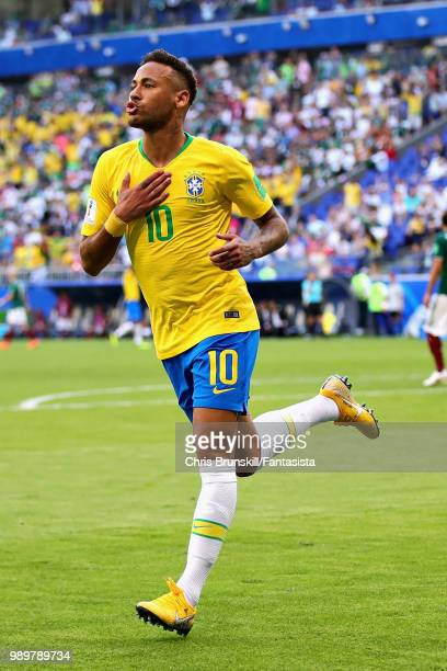 Neymar of Brazil celebrates after scoring his sides first goal during the 2018 FIFA World Cup Russia Round of 16 match between Brazil and Mexico at...