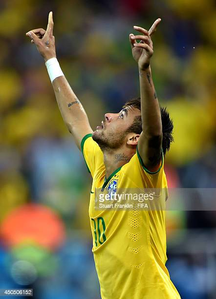 Neymar of Brazil celebrates after scoring the equalizing goal during the 2014 FIFA World Cup Brazil Group A match between Brazil and Croatia at Arena...