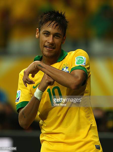 Neymar of Brazil celebrates as he scores their second goal from a free kick during the FIFA Confederations Cup Brazil 2013 Group A match between...