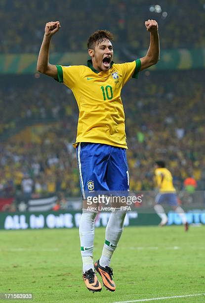 Neymar of Brazil celebrates at the end of the FIFA Confederations Cup Brazil 2013 Semi Final match between Brazil and Uruguay at Governador Magalhaes...