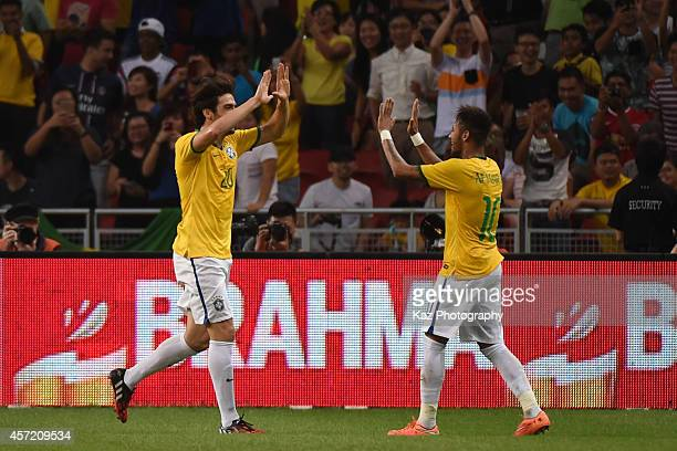 Neymar of Brazil celebrates his 3rd goal with Kaka of Brazil during the international friendly match between Japan and Brazil at the National Stadium...