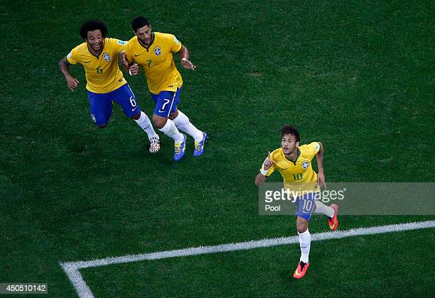 Neymar of Brazil celebrates his goal with Marcelo and Hulk during the 2014 FIFA World Cup Brazil Group A match between Brazil and Croatia at Arena de...