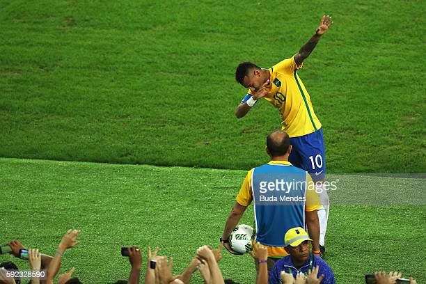 Neymar of Brazil celebrates opening the scoring during the Men's Football Final between Brazil and Germany at the Maracana Stadium on Day 15 of the...
