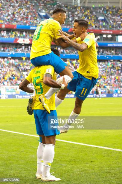 Neymar of Brazil celebrates scoring a goal to make it 1-0 with Paulinho and Philippe Coutinho during the 2018 FIFA World Cup Russia Round of 16 match...