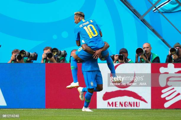 Neymar of Brazil celebrates scoring a goal with Douglas Costa to make it 20 during the 2018 FIFA World Cup Russia group E match between Brazil and...