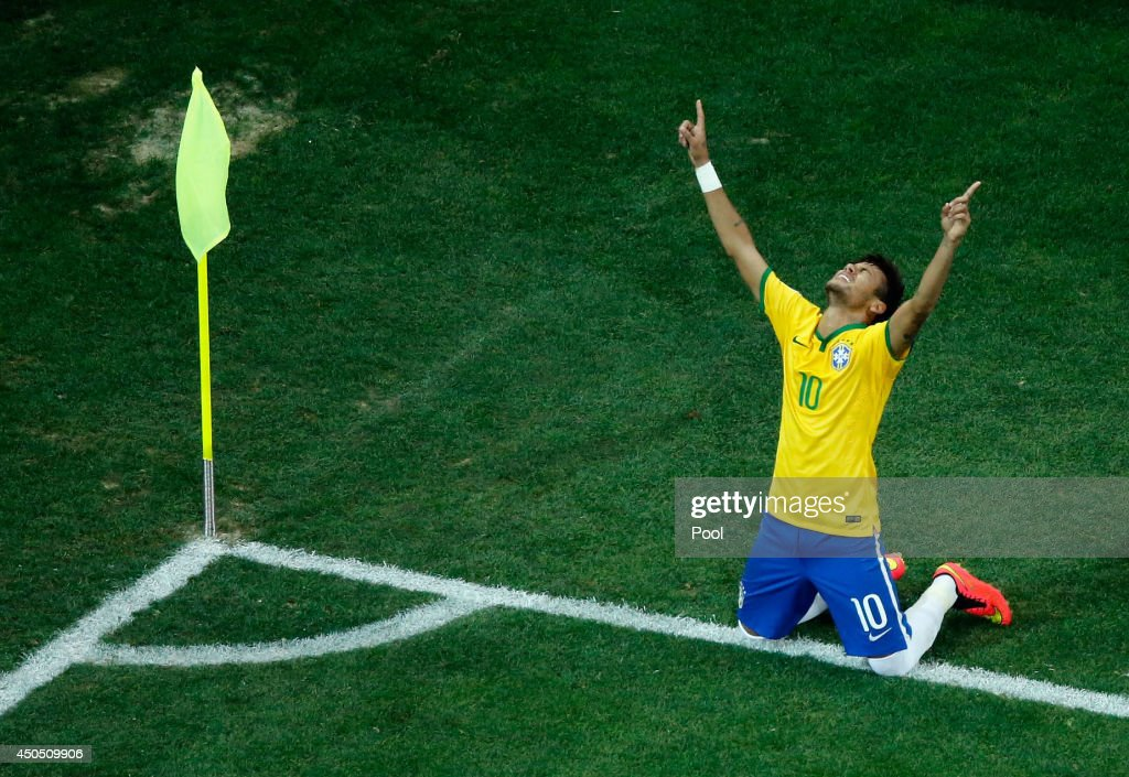 Neymar of Brazil celebrates scoring his second goal on a penalty kick in the second half during the 2014 FIFA World Cup Brazil Group A match between Brazil and Croatia at Arena de Sao Paulo on June 12, 2014 in Sao Paulo, Brazil.