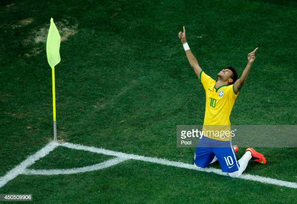 Neymar of Brazil celebrates scoring his second goal on a penalty kick in the second half during the 2014 FIFA World Cup Brazil Group A match between...