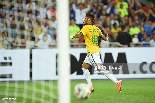 Neymar of Brazil celebrates scoring his team's first goal during the international friendly match between Japan and Brazil at the National Stadium on...