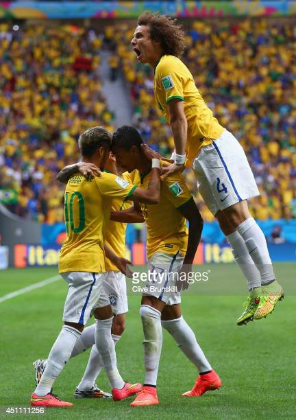 Neymar of Brazil celebrates scoring his team's first goal with Luiz Gustavo and David Luiz of Brazil during the 2014 FIFA World Cup Brazil Group A...