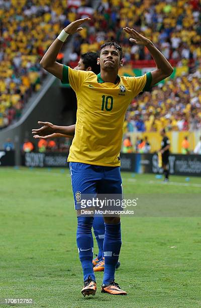 Neymar of Brazil celebrates scoring his team's opening goal during the FIFA Confederations Cup Brazil 2013 Group A match between Brazil and Japan at...