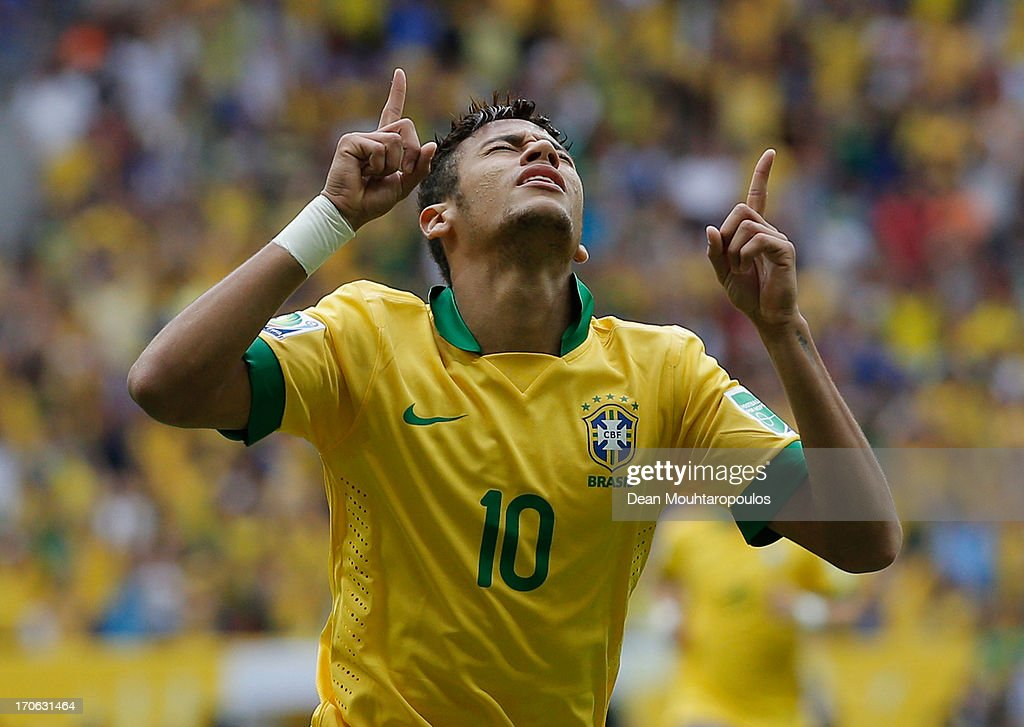 Neymar of Brazil celebrates scoring his team's opening goal during the FIFA Confederations Cup Brazil 2013 Group A match between Brazil and Japan at National Stadium on June 15, 2013 in Brasilia, Brazil.