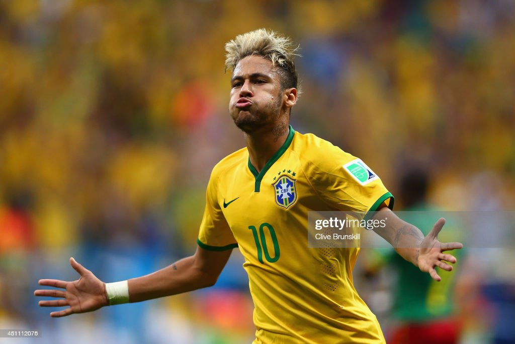 Neymar of Brazil celebrates scoring his team's second goal and his second of the game during the 2014 FIFA World Cup Brazil Group A match between Cameroon and Brazil at Estadio Nacional on June 23, 2014 in Brasilia, Brazil.