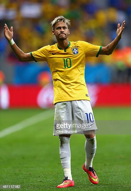 Neymar of Brazil celebrates scoring his team's second goal and his second of the game during the 2014 FIFA World Cup Brazil Group A match between...